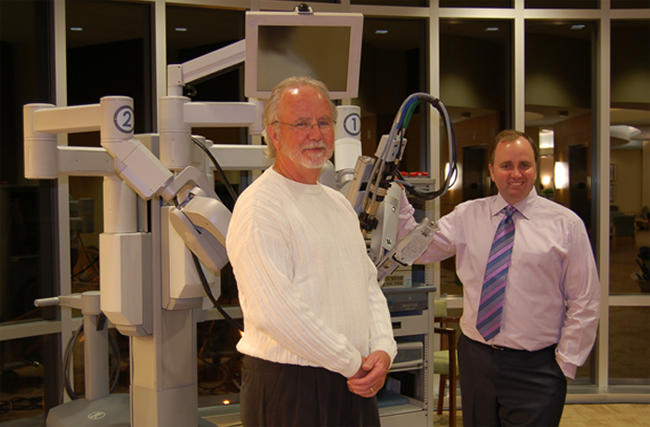 Dr. Michael Bennett and Dr.Jason Bennett with the da Vinci Robot